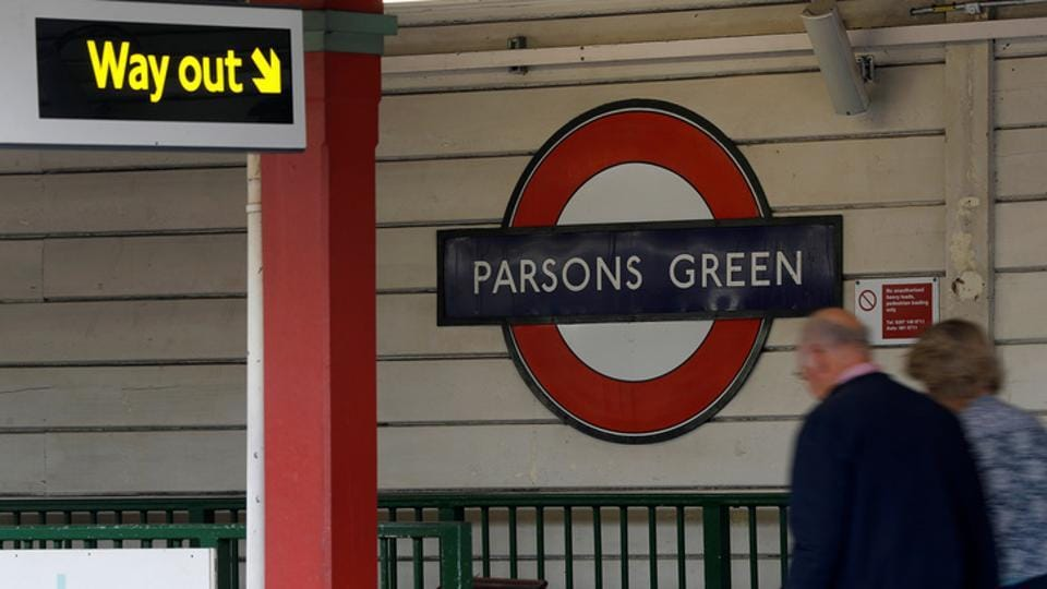 Passengers leave Parson's Green Underground station after it reopened following an explosion on a rush hour train Sunday morning, in London.