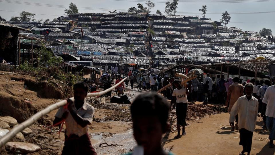 Rohingya refugees walk through a camp in Cox's Bazar in Bangladesh. More than 430,000 Rohingya Muslims have fled to Bangladesh from Myanmar.