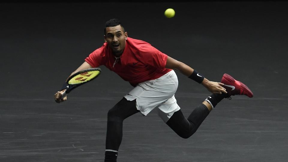 Australian Nick Kyrgios of Team World returns the ball to Swiss Roger Federer of Team Europe. (AFP)