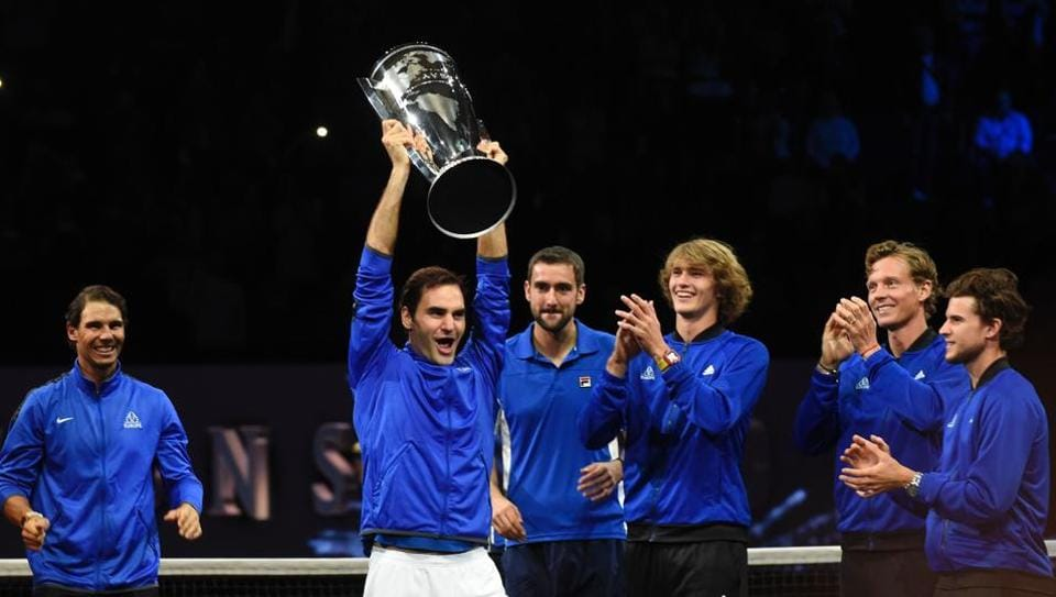 Roger Federer of Team Europe and his teammates celebrate with the Laver Cup trophy on Sunday.