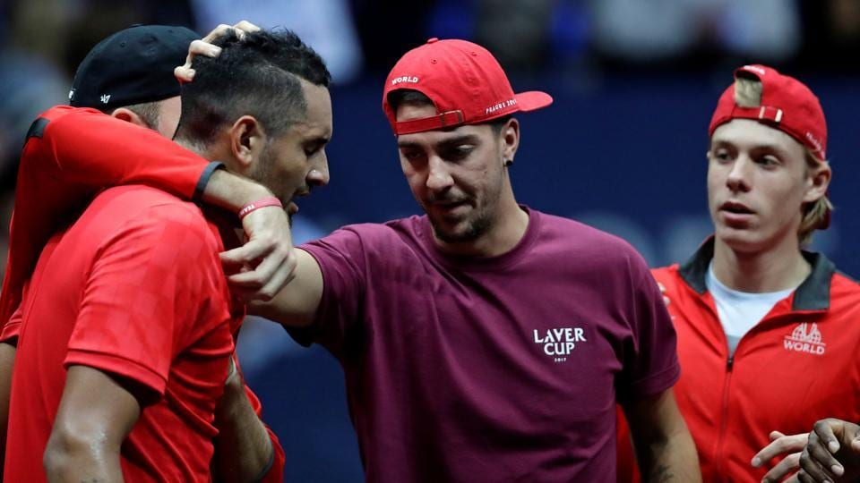 Nick Kyrgios of team World is comforted by team mates after his loss against Roger Federer. (REUTERS)