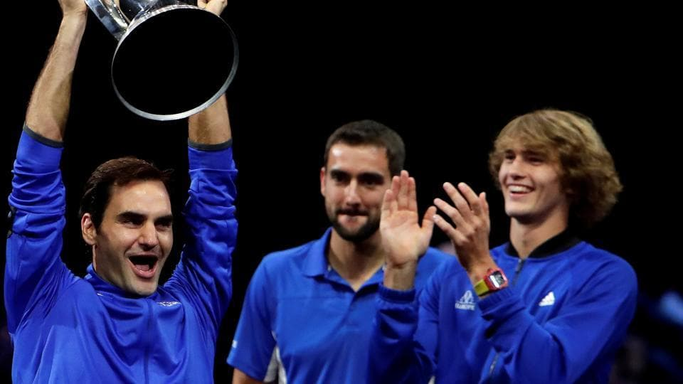 Roger Federer celebrates the win with teammates Marin Cilic and Alexander Zverev. (REUTERS)