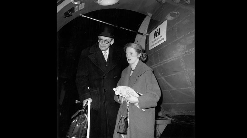 T. S. Eliot with his second wife Valerie (1926 - 2012), returning from their French honeymoon on the BEA (British European Airways) Airspeed AS 57 Ambassador, 'Sir Walter Raleigh,' February 01, 1957. (Ronald Dumont / Express / Hulton Archive / Getty Images)