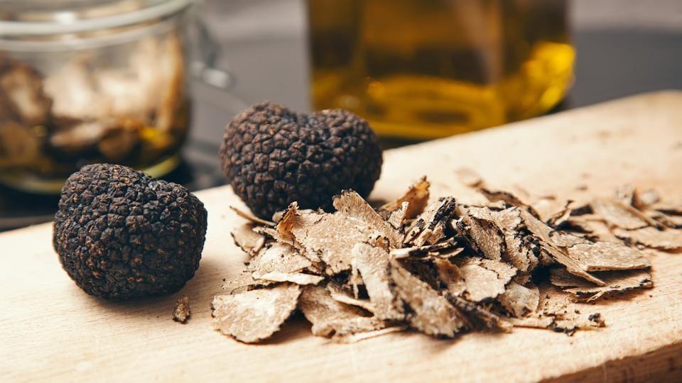 Black truffles on a wood board.