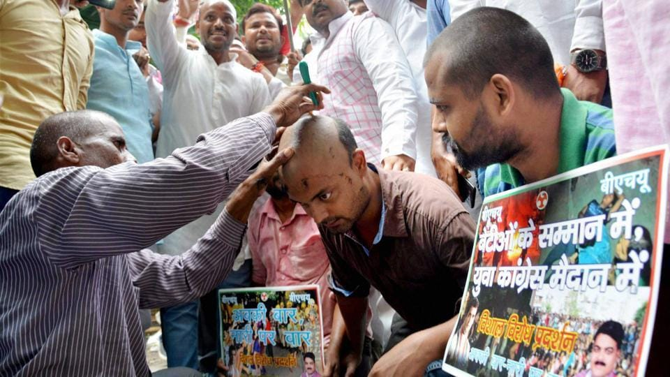 Activists of Youth Congress get their heads shaved during a protest against the police lathi charge on the female students of BHU. Several universities and colleges have seen unrest in the recent past for various reasons, including 'anti-national' slogans being raised in JNU and the suicide of a Dalit scholar in Hyderabad Central University, Hyderabad. (PTI)