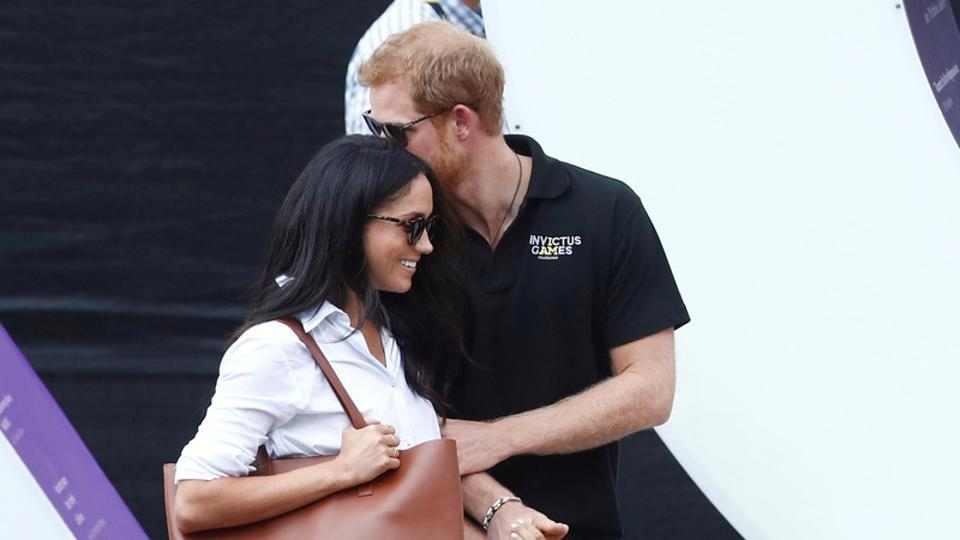 Prince Harry arrives with girlfriend Meghan Markle at the wheelchair tennis event during the Invictus Games in Toronto.