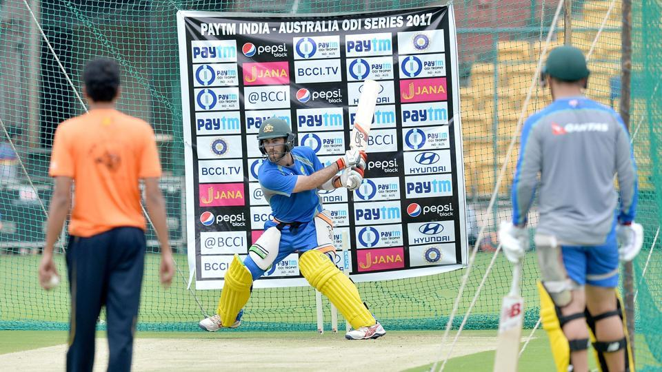Glenn Maxwell attempts a reverse slog during a practice session ahead of the fourth ODI at the M. Chinnaswamy Stadium in Bangalore.  (AFP)