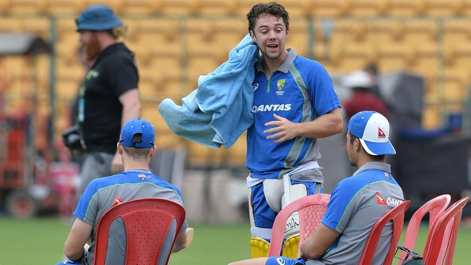Travis Head (C) speaks with teammates after batting during a practice session ahead of the fourth ODI at the M. Chinnaswamy Stadium in Bangalore.  (AFP)