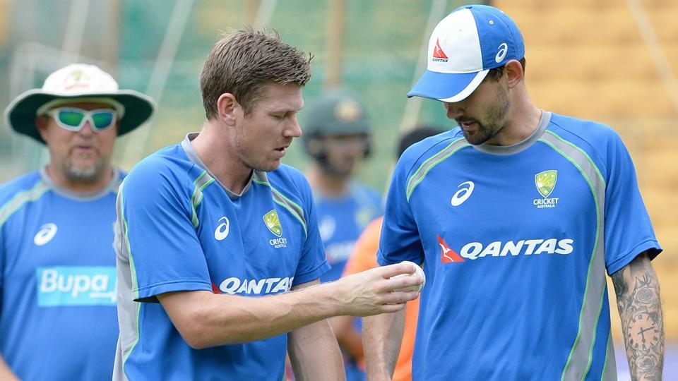 James Faulkner and Kane Richardson (R) talk during a practice session ahead of the fourth ODI at the M. Chinnaswamy Stadium in Bangalore.  (AFP)