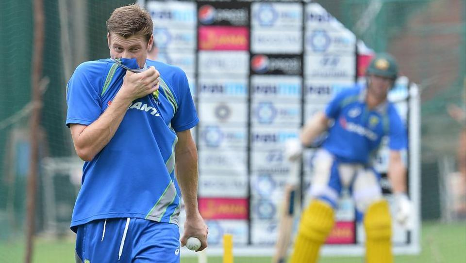 Australian cricketer James Faulkner prepares to bowl during a practice session ahead of the fourth One Day International (ODI) match of the ongoing India-Australia cricket series at the M. Chinnaswamy Stadium in Bangalore on September 26, 2017.