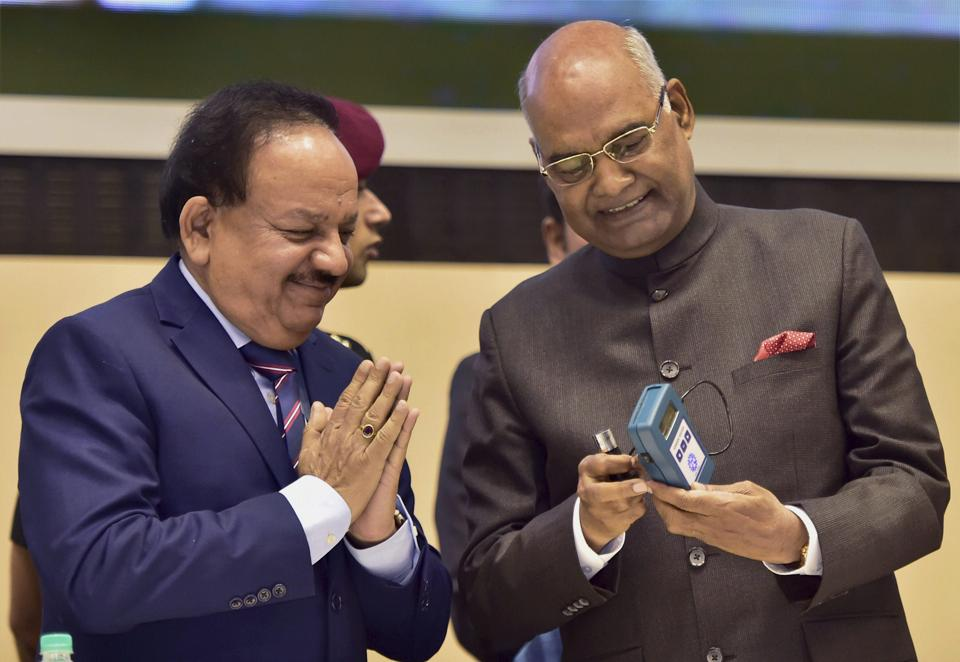 President Ram Nath Kovind with Union Minister for Science & Technology & Earth Sciences Harsh Vardhan admires a device to check milk adulteration invented by CSIR .