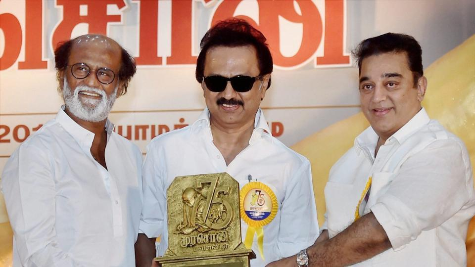 DMK Working President MK Stalin along with actor-filmmaker Kamal Haasan presenting memento to Rajnikanth at the Diamond Jubilee celebration of the party's mouthpiece Murasoli in Chennai on Thursday.