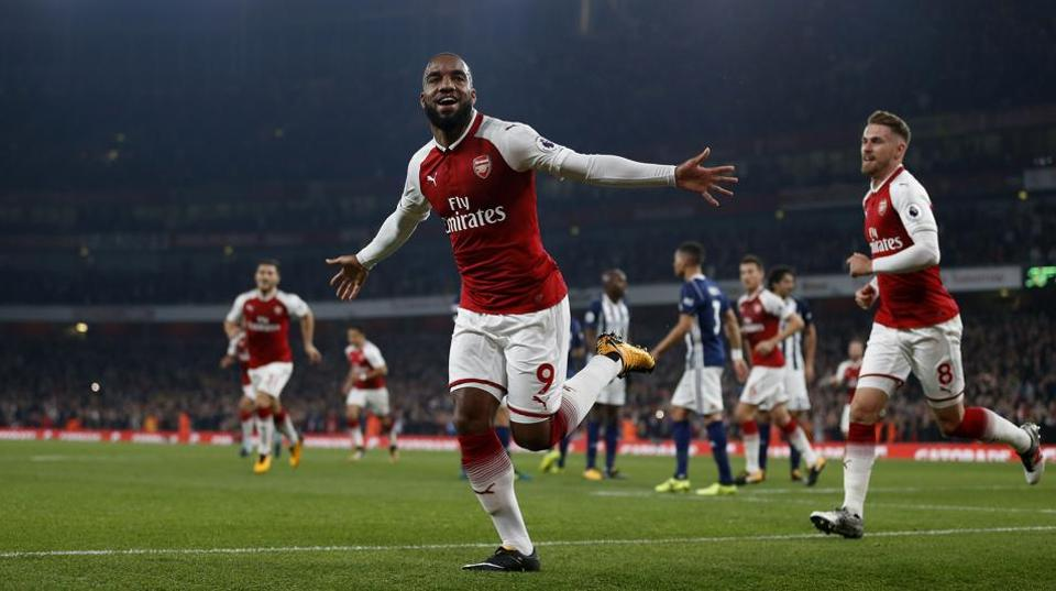 Arsenal's French striker Alexandre Lacazette celebrates scoring his team's first goal during the Premier League match against West Brom at the Emirates Stadium in London on Monday.
