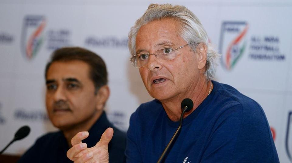Former Portuguese footballer and India's FIFA U-17 football team coach Luis Nortan De Matos (R) speaks next to All India Football Federation president Praful Patel during a press conference in New Delhi on September 26, 2017.