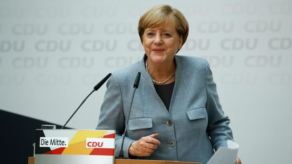 German Chancellor Angela Merkel leaves after giving a press conference at the headquarters of the Christian Democratic Union (CDU) party in Berlin on September 25, 2017, one day after general elections. Merkel woke up to a fourth term but now faces the double headache of an emboldened hard-right opposition party and thorny coalition talks ahead