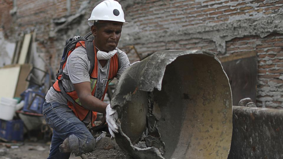 Hector Rodarte Cedillo, a 27-year-old window washer and candy salesman, lost his right leg below the knee seven years ago when a car ran him over. That hasn't stopped him from toiling long hours in a brigade of civilian volunteers searching for survivors, aiding the injured and clearing the rubble of buildings that collapsed in Jojutla during last week's deadly earthquake. (Miguel Tovar / AP)