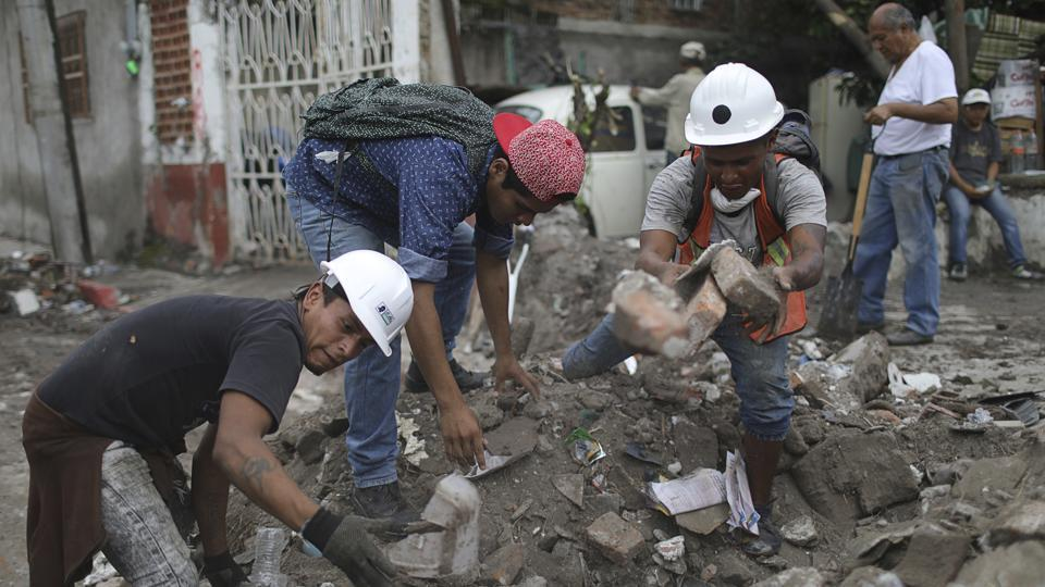Hector Rodarte (2nd R), helps salvage personal items from a neighbor's home, destroyed in a 7.1 magnitude earthquake, in Jojutla, Mexico. Rodarte says helping others 'is something that is born from the bottom of my heart.' Jojutla, about 60 miles (100 kilometers) south of the Mexican capital, is one of the places hit hardest by the September 19 quake, which killed at least 326 people. (Miguel Tovar / AP)