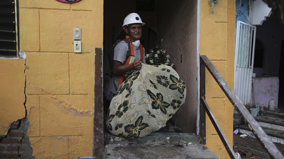 The largest rescue efforts following the quake are underway at an office building in the Roma section of Mexico City where 40 people may be buried, based on families who have reported relatives missing. Asked on Monday how much longer search and rescue operations would continue, Punete said, 'As of today, we have agreed to another 72 hours.' Dogs trained to pick up the scent of survivors have yet to find any signs of life at the search sites, he said. (Miguel Tovar / AP)
