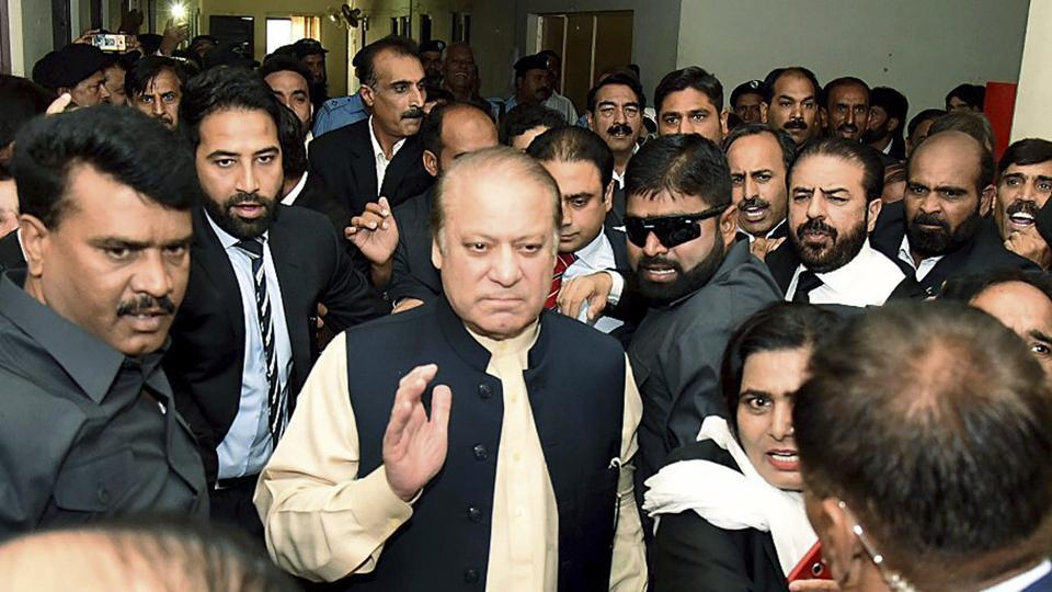 In this photo released by the PML-N party, deposed premier Nawaz Sharif arrives at an anti-corruption court in Islamabad on September 26, 2017. Sharif made his first appearance in the court to face corruption charges. He was disqualified by the Supreme Court on July 28 following a probe that concluded he had concealed financial assets.