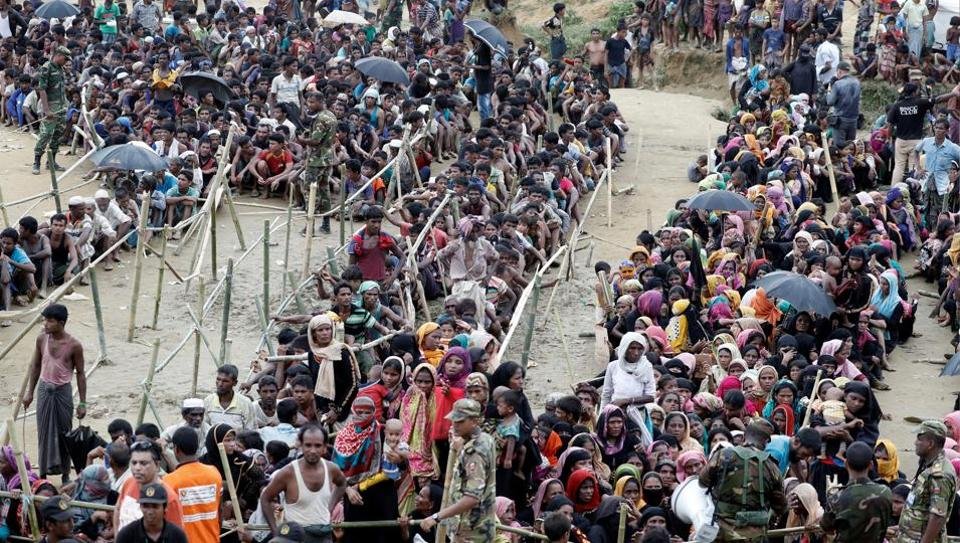 Rohingya refugees queue for aid at Cox's Bazar, Bangladesh on September 26.