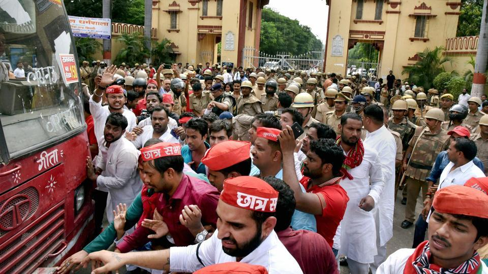 Police removes Samajwadi Party workers who were trying a protest at BHU gate against the police lathicharge in Varanasi on Monday. The Samajwadi Party president Akhilesh Yadav tweeted after the police crackdown: 'The government should resolve the issue by talks, not by lathicharge. It is condemnable. Action should be taken against the guilty.' (PTI)