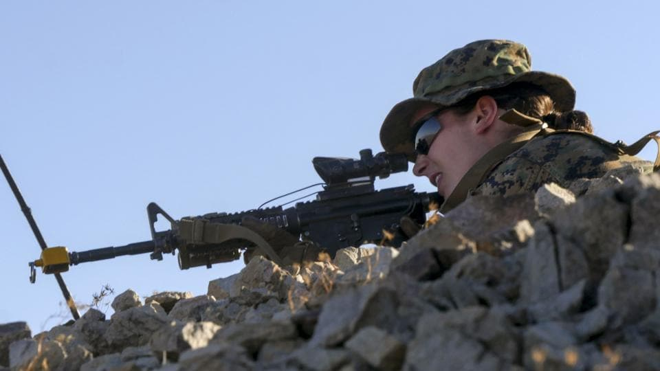 This US Marine Corps photo obtained September 25, 2017 shows an unidentified Marine as she participates in an exercise during the Infantry Officer Course at Marine Corps Air Ground Combat Center Twentynine Palms, California.