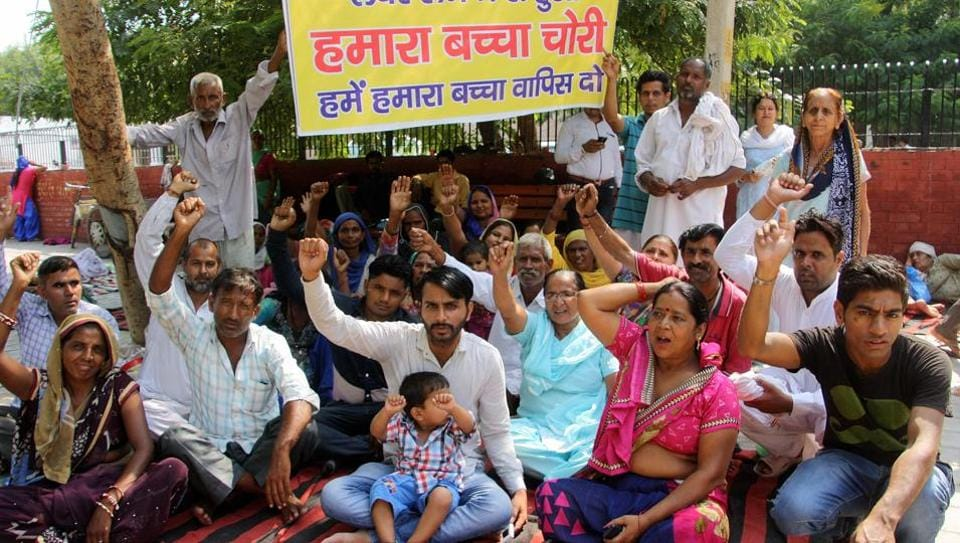 Residents protest the disappearance of a newborn from the gynaecology ward of PGIMS-Rohtak on the institute premises. Hospital director Dr Rakesh Gupta had resigned twelve days after the incident.
