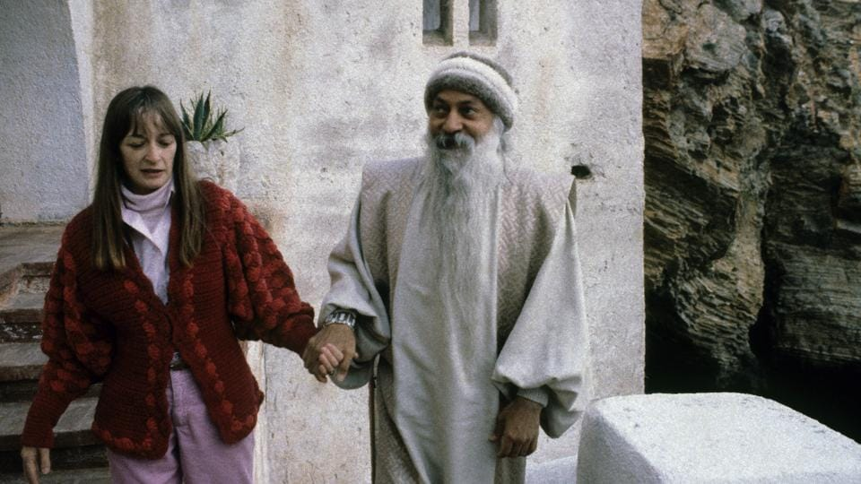 Osho's caretaker Nirvano seen here with Osho Rajneesh.