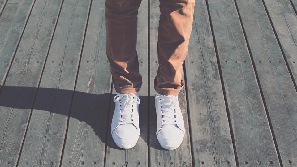 White sneakers have been trending since quite a while now.