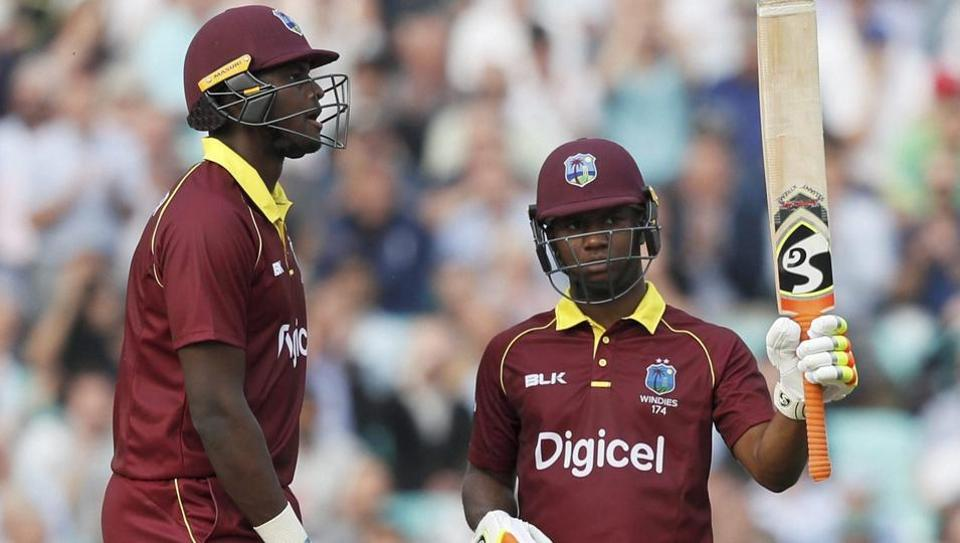 West Indies' Evin Lewis, right, celebrates scoring 176 runs during the 4th ODI against England at The Oval in London on Wednesday.