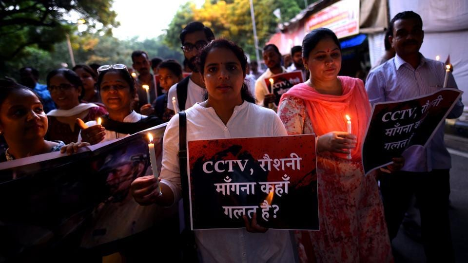 Students at a candle-light protest at Jantar Mantar in New Delhi against lathicharge on students of BHU.