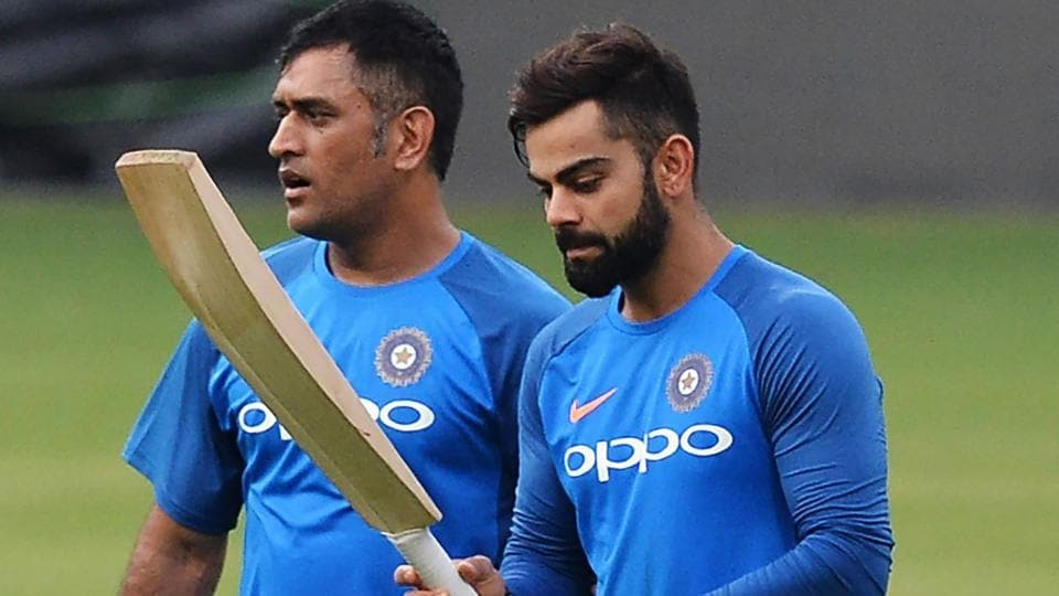 Virat Kohli (R) and MS Dhoni arrive for a practice session ahead of the fourth One Day International (ODI) between India and Australia  at the M. Chinnaswamy Stadium in Bangalore.  (AFP)