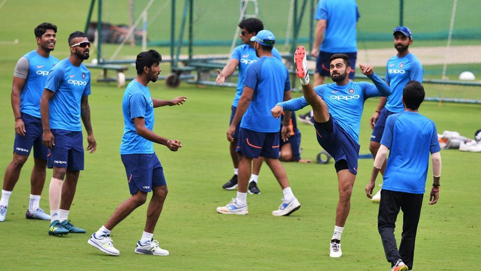 Indian cricket team captain Virat Kohli (3R) plays football with his teammates during a practice session ahead of the fourth One-Day International (ODI) against Australia at the M. Chinnaswamy Stadium in Bangalore on Wednesday.