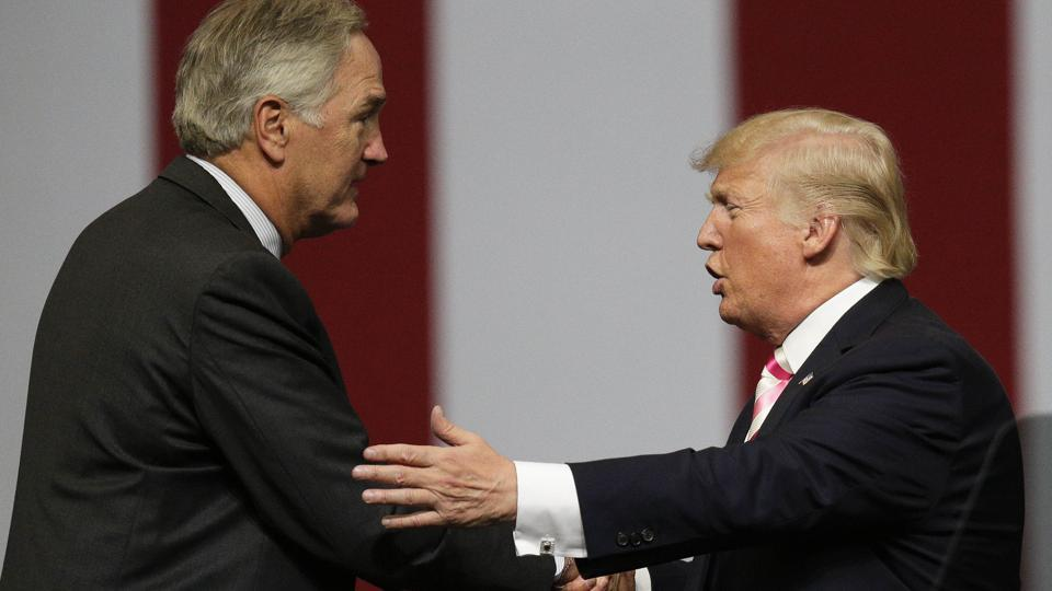 President Donald Trump shakes the hand of Sen. Luther Strange after he speaks at campaign rally, Friday, Sept. 22, 2017, in Huntsville, Ala.