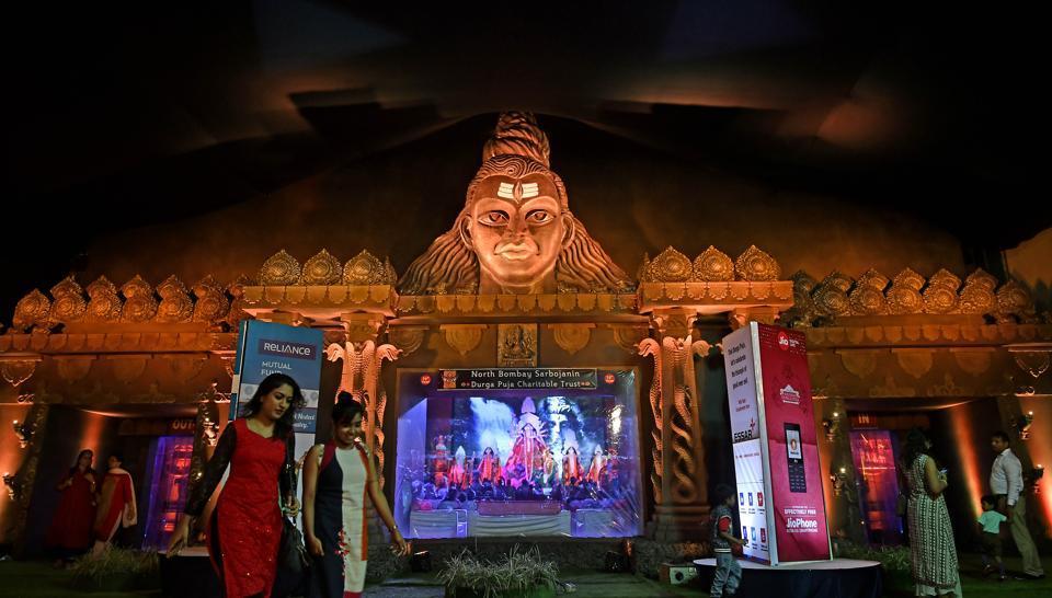 People visit a Durga puja pandal at Tulip Star, Juhu , on Tuesday.