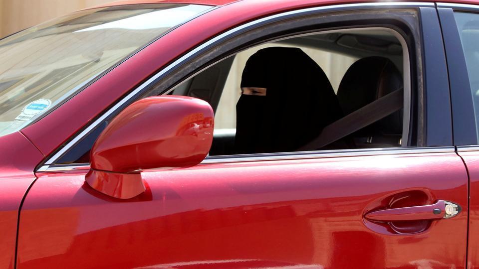 A woman drives a car in Riyadh, Saudi Arabia.