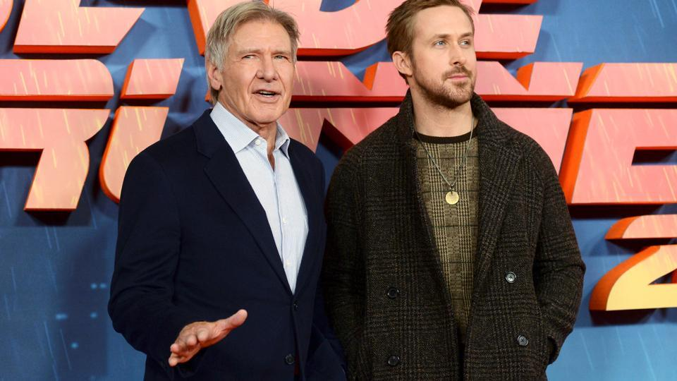 Harrison Ford poses with Ryan Gosling during a photocall to promote Blade Runner 2049 at a hotel in central London.