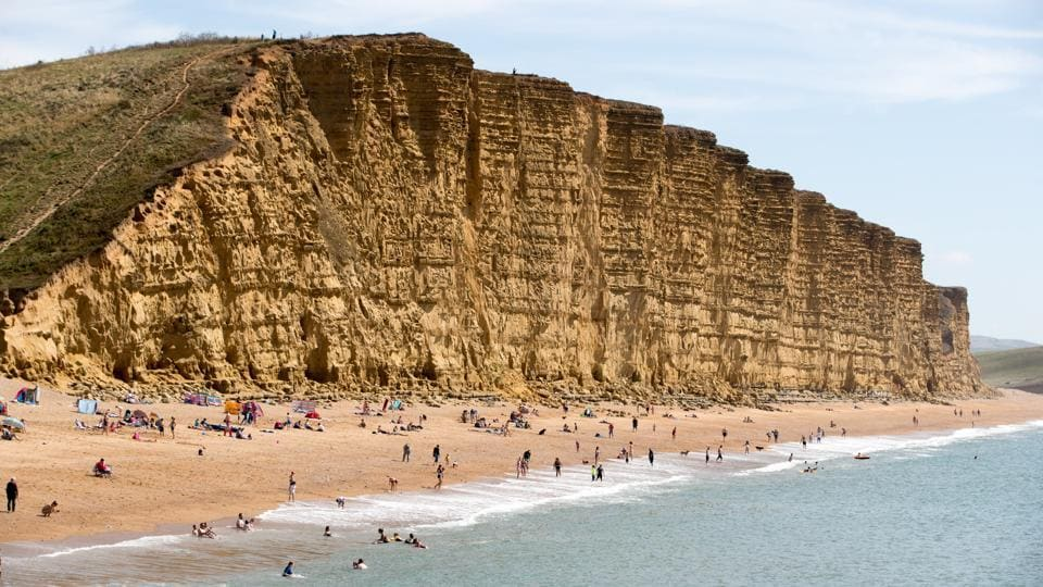 In Dorset, England, the East Cliff is a popular beach destination on the West Bay. West Bay beach was used in the introduction to the BBC television series 'The Fall and Rise of Reginald Perrin' and for location filming in the television series 'Harbour Lights.'  (Matt Cardy  / Getty Images)