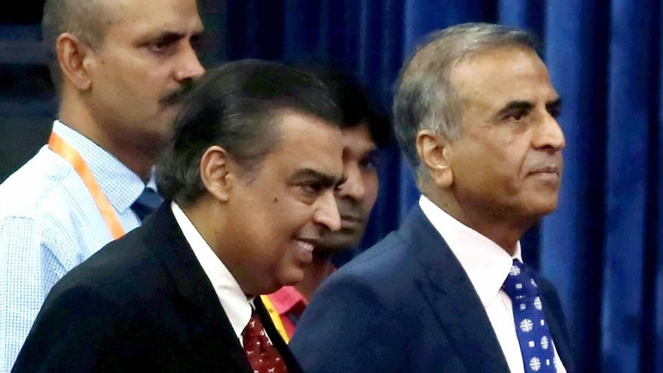 "Reliance Industries chairman Mukesh Ambani and Bharti Enterprises chairman Sunil Bharti Mittal arrives for inauguration of the ""India Mobile Congress 2017"", in New Delhi on Wednesday."