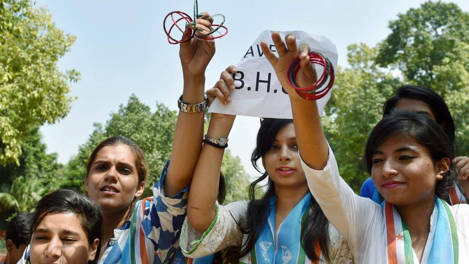 NSUI members demonstrating with bangles against the police action on Banaras Hindu University (BHU) girls, in New Delhi on Monday.