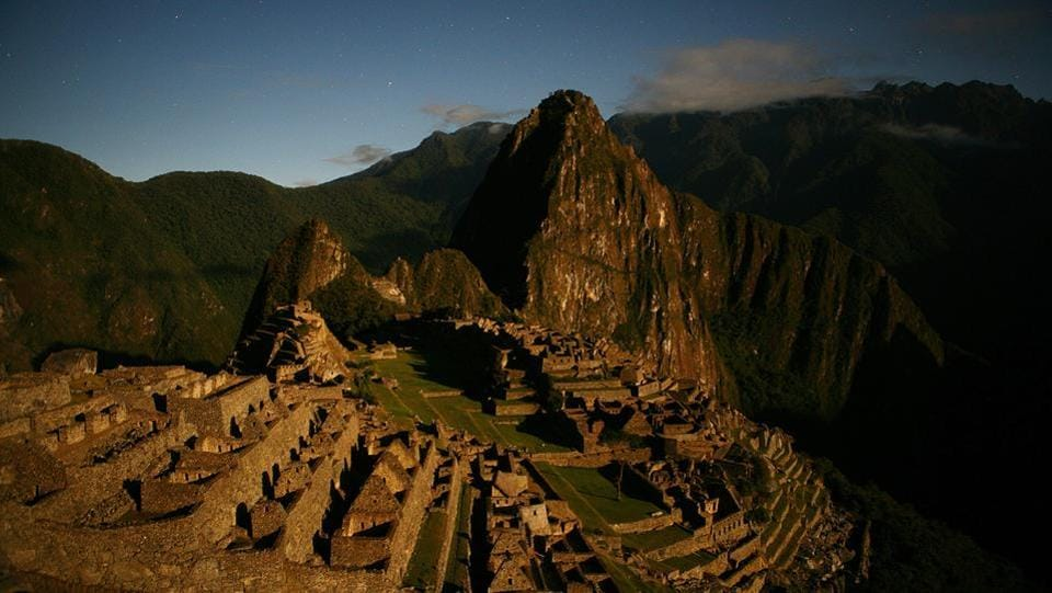 Macchu Pichu as seen under a golden sun in Peru. This Inca city seems forever stuck in time and was never revealed to the warrior Spaniards until the early part of the 20th century. Today is however a different story, as 2500 people arrive there daily during peak season.  (Brent Stirton / Getty Images)