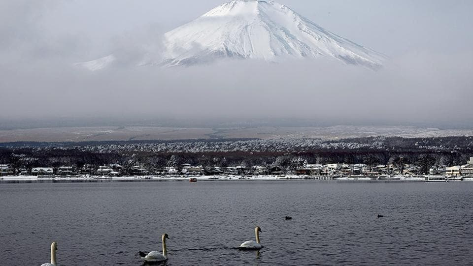 In the land of the rising sun, Mount Fuji is what is visible to most travelers from even the aeroplane. Here, the snow-capped peak is seen from the Yamanakako lake in Japan on a cold January day. (Koichi Kamoshida / Getty Images)
