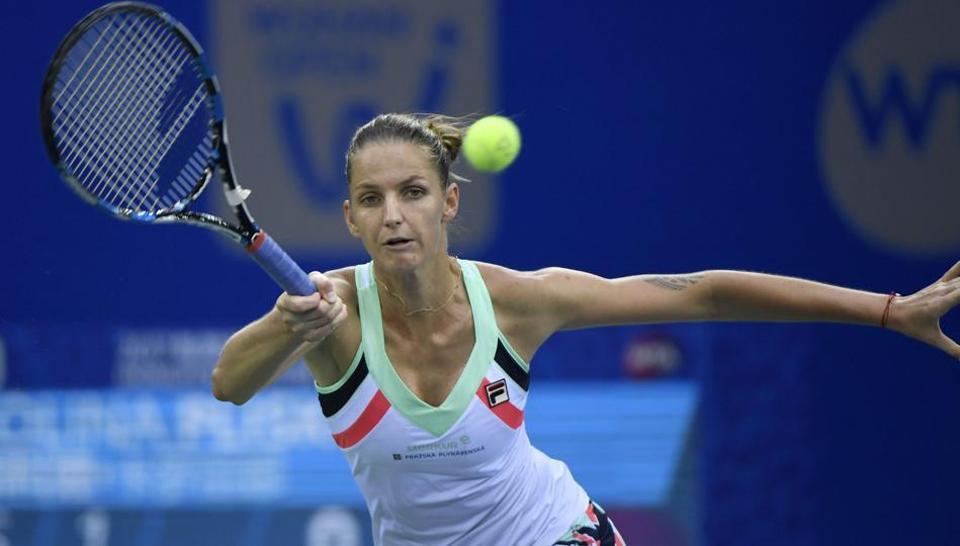 Karolina Pliskova of Czech Repubic returns to Wang Qiang of China during the third round of the WTA Wuhan Open tennis tournament on Wednesday.
