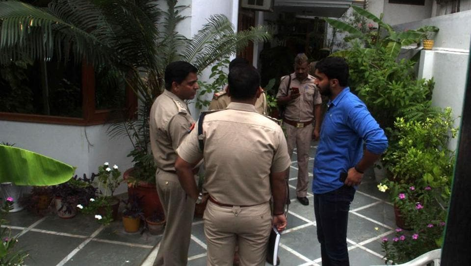 Police at a home in Noida's Sector 44 where an armed robbery occurred
