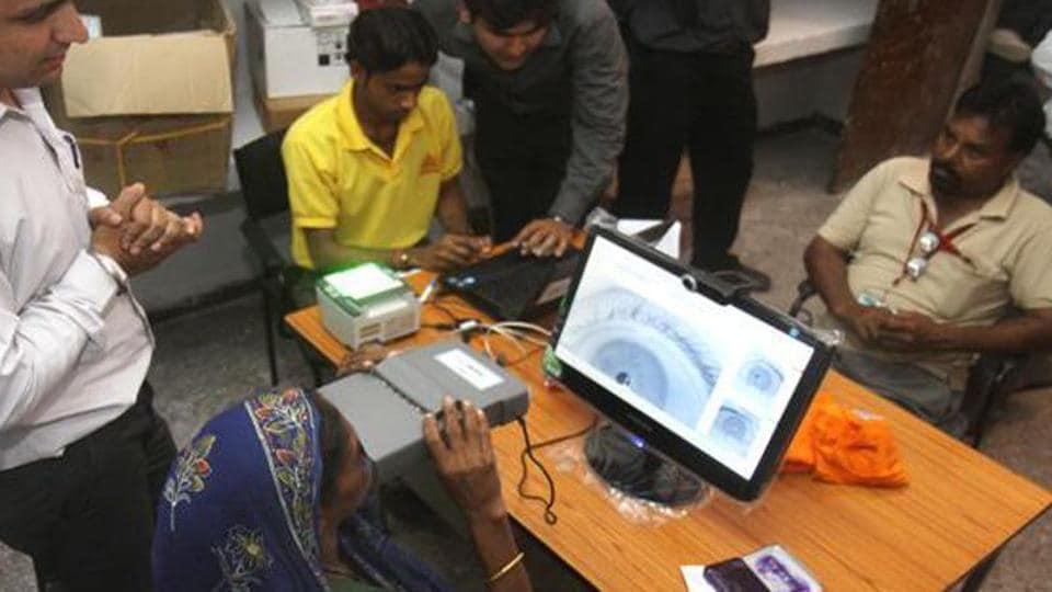 A woman undergoing iris scan as part of applying for Aadhaar card.