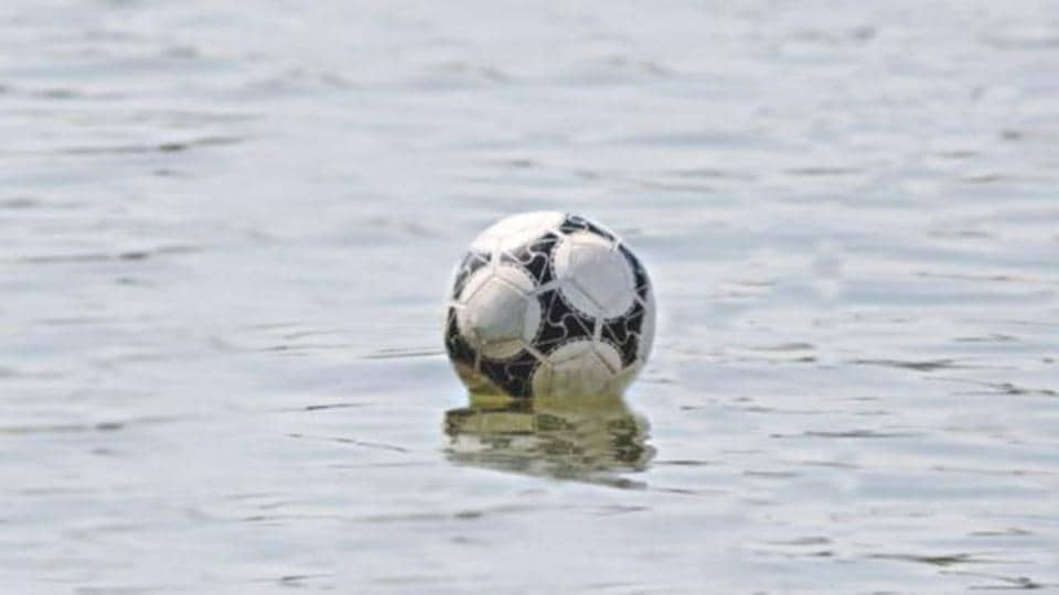 A football game in Romania was abandoned after all the match balls had been hit into a nearby river.