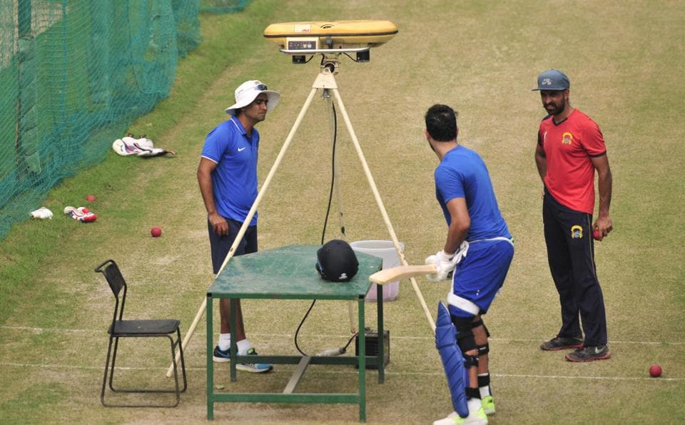 Punjab Ranji Trophy team's new coach Ajay Ratra (left) with Yuvraj Singh (centre)during a training session in Mohali on Thursday.
