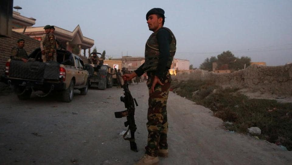 Afghan security forces keep watch at the site of an attack and gun fire between insurgents and Afghan forces in Kabul, Afghanistan September 27, 2017.