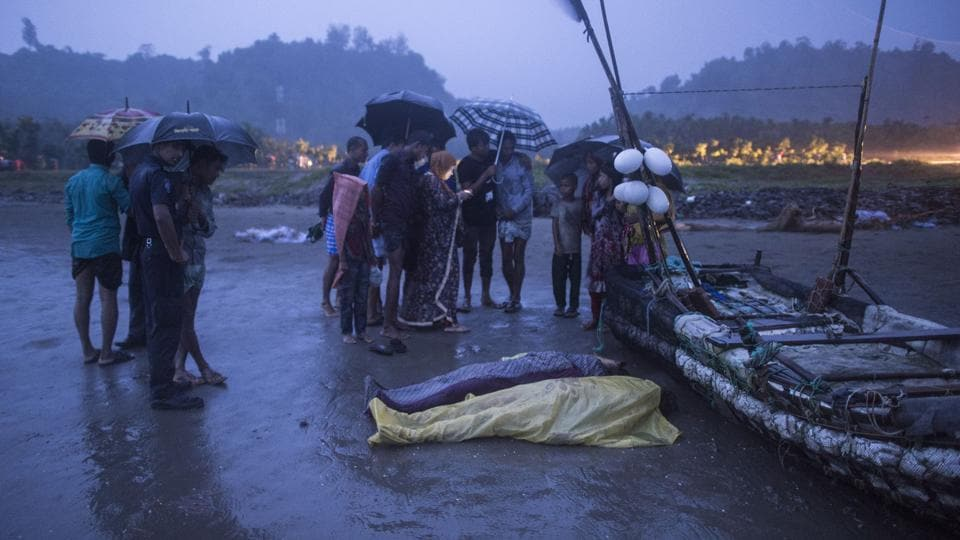 People gather around bodies of Rohingya Muslim refugees, on the shore of Inani beach, near Cox's Bazar on September 28.