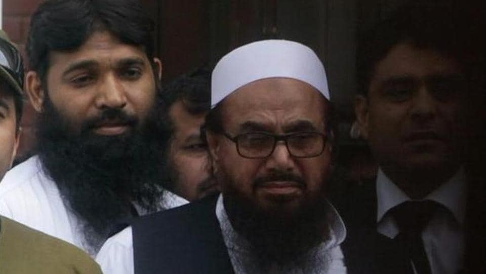 Hafiz Saeed (right), chief of the Jamaat-ud-Dawa (JuD), leaves after appearing in a court to challenge his house arrest in Lahore, Pakistan, on May 13, 2017.